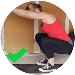 A lady showing the correct Squat position
